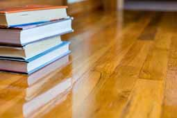 Pile of books on Rustic Oak narrow strip Hardwood floor