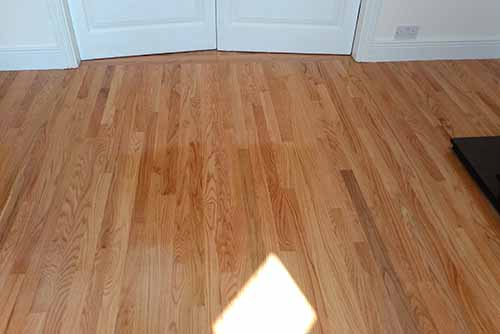 Red oak wood floor fitted in dining room - wood flooring product