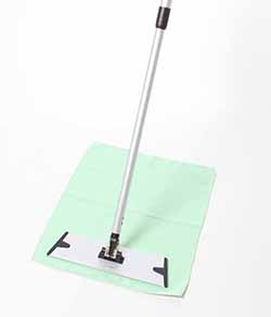 Floor mop placed on green waffle floor cloth