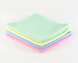 Pile of Waffle Floor Cloths in pink, blue, yellow and green