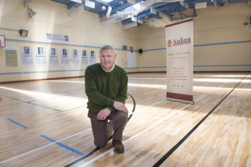 Company proprietor Tom Stanton standing on newly refurbished hardwood floor in Ballyphehane community centre